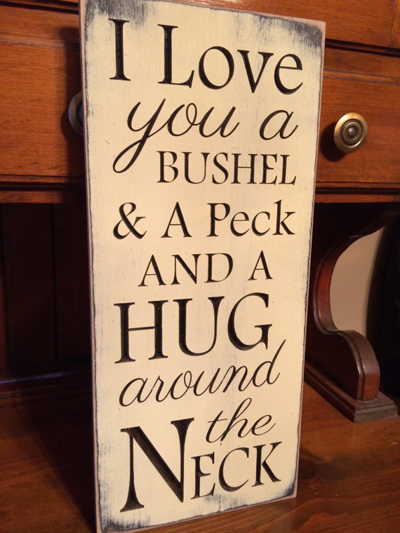 Kiss and a peck and a hug around the neck